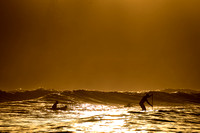 Sumner surfing at sunset